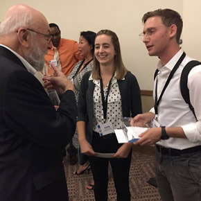 Carly Warren and David Gafni discussing their award with Dr. Marvin Danoff, Past President of the Human Factors and Ergonomics Society.