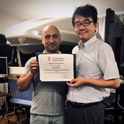 Husam Muslim (on the left ) being congratulated by his Professor, Makato Itoh.
